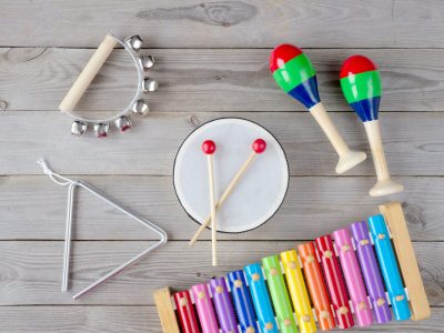 frame made of music accessories for children on white background