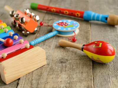 Musical instruments on wooden background